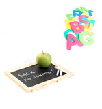 Back to school. Blackboard and chalk with green apple - back to school Stock Photos