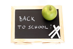 Back to school. Blackboard and chalk with green apple - back to school Royalty Free Stock Photo