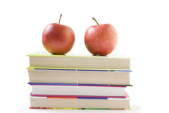 Back to school. Two apples on five books on a white background Stock Image