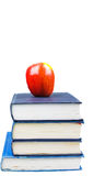 Back to school. A apple on top of books on a white background education concept Stock Images