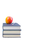 Back to school. A apple on top of books on a white background education concept Royalty Free Stock Photography
