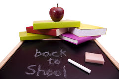 Back to School. Letters written on a blackboard with colorful books (selective focus Stock Image