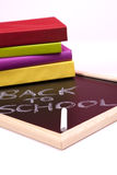 Back to School. Letters written on a blackboard with colorful books (selective focus Stock Photo