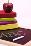 Back to school. Letters written on a blackboard with colorful books (selective focus Stock Images