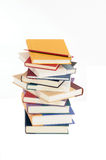Back to School. A pile of books with a pencil set against a white background Stock Images