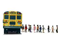 Back to School. School children boarding on a school bus Stock Image
