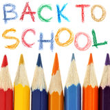 Back to school. Crayons and back to school text over white background Stock Photography
