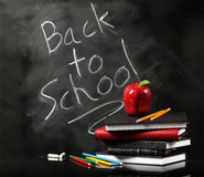 Back to school. On chalkboard with school supplies Royalty Free Stock Photography