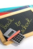 Back to school. School supplies and calculator on white background royalty free stock images