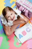 Back to school. Early education - Happy schoolgirl with notebooks Stock Photos