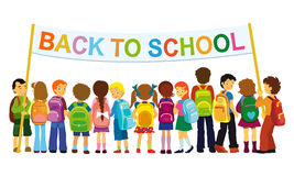 Back to school. Group of elementary school pupils standing with large banner Stock Photography