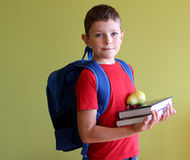 Back to school. Boy ready for school with books and school backpack Royalty Free Stock Photo