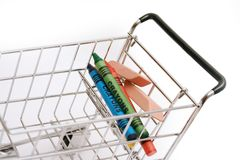 Back to School. Minature shopping cart  - Carrying generic school items Stock Image