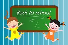Back to school. Two happy little girls enjoying being back to school and jump in front of a blackboard with the headline Back to School Royalty Free Stock Photos