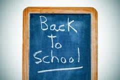 Back to school. Sentence back to school written in a vintage blackboard Stock Photo