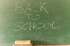 Back to school. Writing with chalk on a blackboard in a school Royalty Free Stock Image