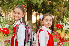 Back to School. Two pretty young girls on their way to school royalty free stock image