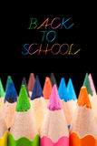 Back to school. Written on chalkboard with multicolored pencil crayons Royalty Free Stock Images
