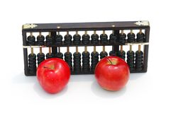 Back to school. Chinese abacus and red apples isolated on white Stock Photo