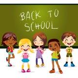 Back to School. Five children happy back to school standing in front of classroom chalkboard Stock Image