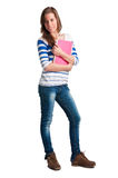 Back to School. Young woman carrying notebooks in her arms Stock Photo
