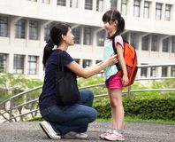 Back to school. Happy asian mother with daughter in school Stock Photography