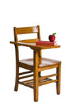 Back to School. A wooden desk with an apple and a red book. Isolated on white Stock Image