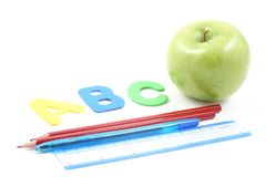Back to school. Abc green apple and some school supplies Stock Images