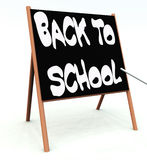 Back To School 4. An image of a advert of a back to school sign written on a blackboard with some white chalk Royalty Free Stock Images