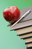 Back to school. Books, apple and pencil stock images