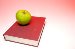 Back to School. Concept- An apple on a book Stock Photo