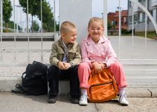 Back to school. Children in front of the school yard stock photography