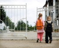 Back to school. Pupils entering the school building on the first day of school Royalty Free Stock Photography