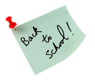 Back to School. Post it note that reads Back to School and a pin, isolated in white background royalty free stock photos