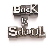 Back To School. The phrase Back To School done in random letterpress type on a white paper background royalty free stock photos