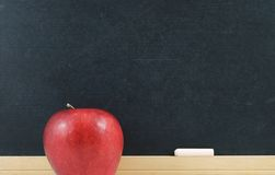 Back to School. Chalkboard with chalk and an apple Royalty Free Stock Photo