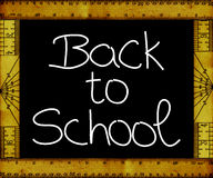 Back to school. Hand-written on blackboard with frame made of vintage rulers Royalty Free Stock Photography
