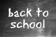 Back to school. Written in chalk on an old blackboard Stock Image