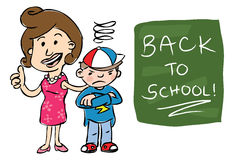 Back to school. Smiling mother giving camera thumbs up standing beside grumpy son with Back to School! text on chalkboard Stock Photo