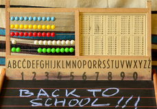 Back to school. Abacus, blackboard, alphabet and numbers Stock Images