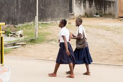 Back to school. Abidjan, ivory coast at about half past ten, the two girls went home with good conversation. In Ivory coast female students wear the blue and Royalty Free Stock Photos