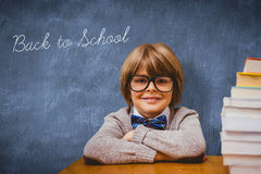 Back to school against blue chalkboard. The word back to school and pupil with many books against blue chalkboard royalty free stock photos