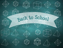 Back to school against green chalkboard Royalty Free Stock Photos