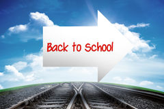 Back to school against railway leading to blue sky Royalty Free Stock Image