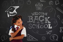 Composite image of back to school. Back to school against schoolgirl standing against blackboard in classroom stock illustration