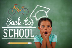 Composite image of back to school. Back to school against surprised young girl Royalty Free Stock Image
