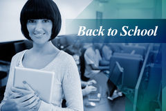 Back to school against teacher with tablet pc Stock Photography