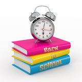 Back to school. Alarm clock on books. Stock Image