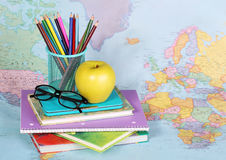 Back to school. An apple, colored pencils and glasses Royalty Free Stock Photo