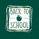 Back to school with apple in frame over green old paper. Back to school text with apple symbol in frame over green old paper background, education concept Stock Photos